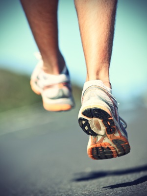 Running shoes on runner