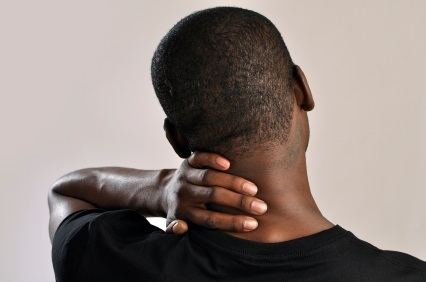 man rubbing the back of his neck