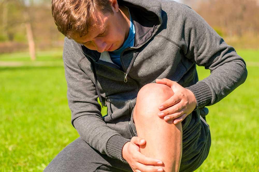 man checking his knee