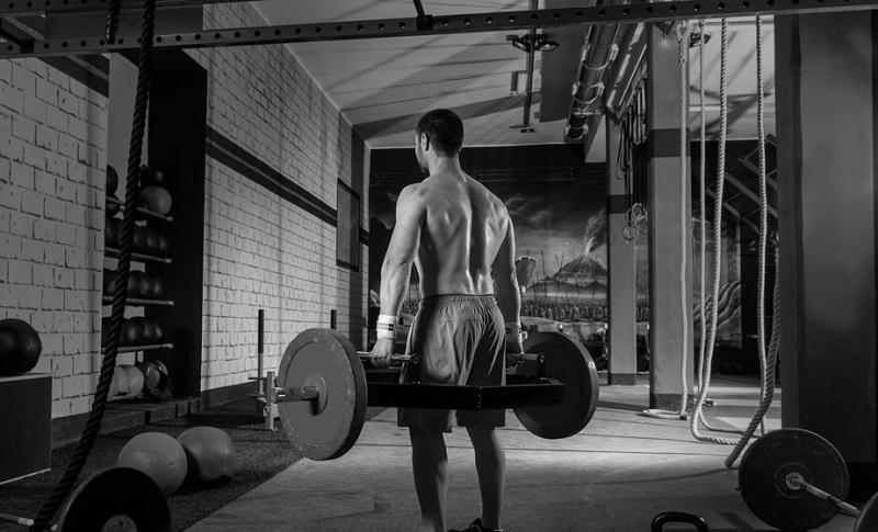 Man Deadlifting heavy weights