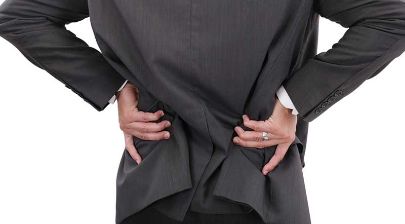man in suit with lower back pain