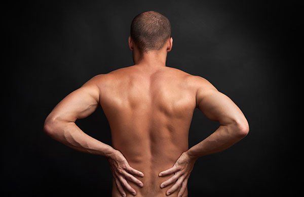 man holding his lower back