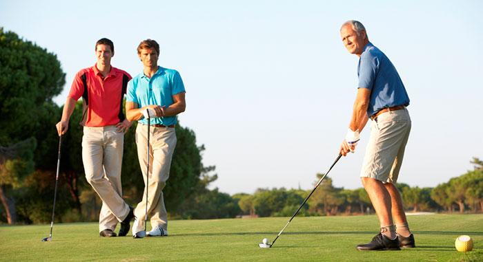 men on the golf tee