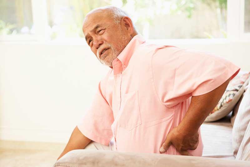 Senior man with sharp back pain