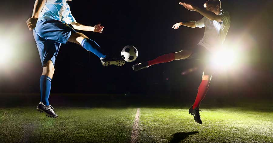 soccer players kicking